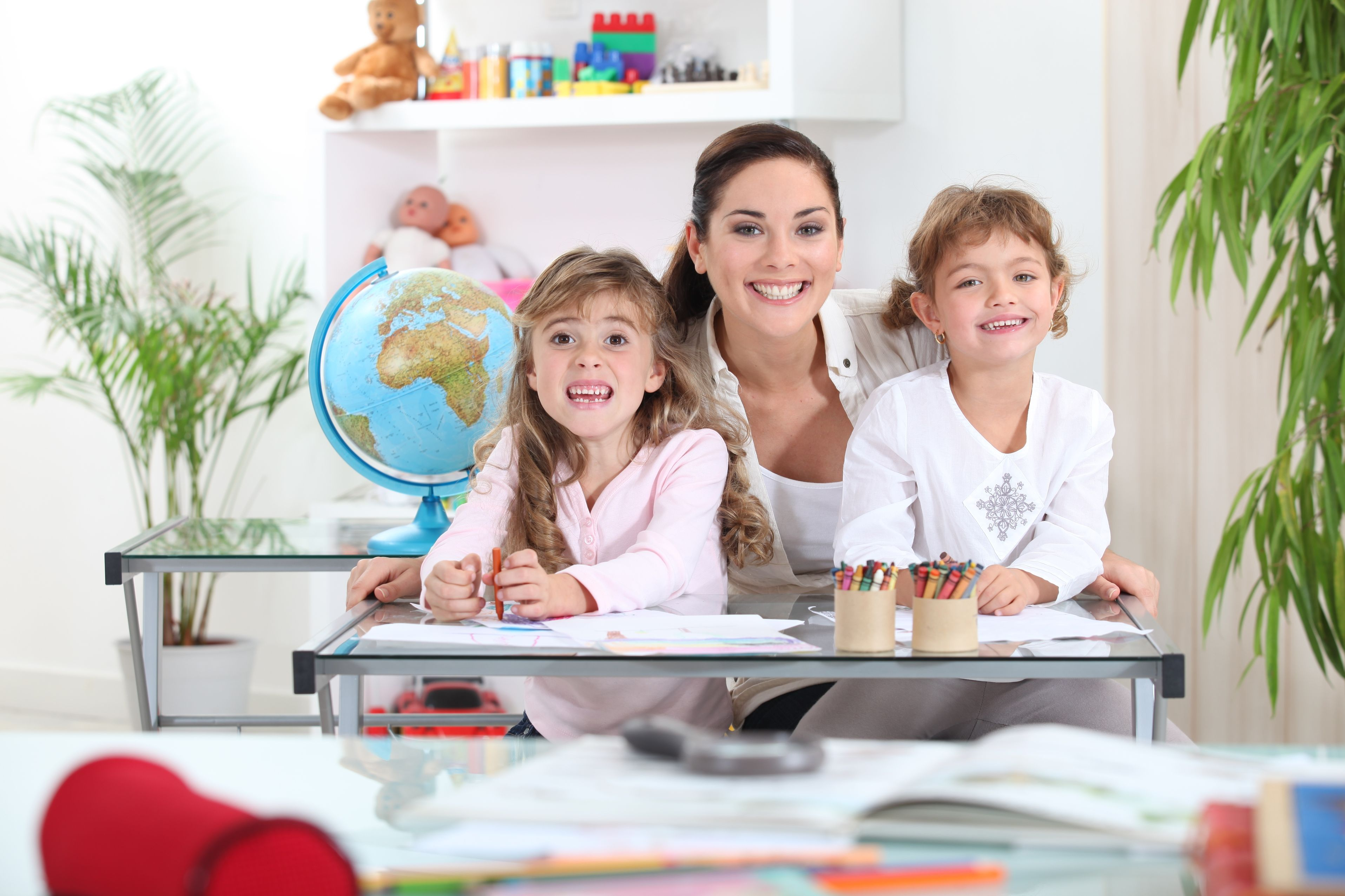 early childhood educator with day care children